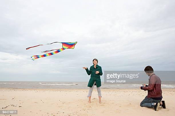Couple on a beach with kite