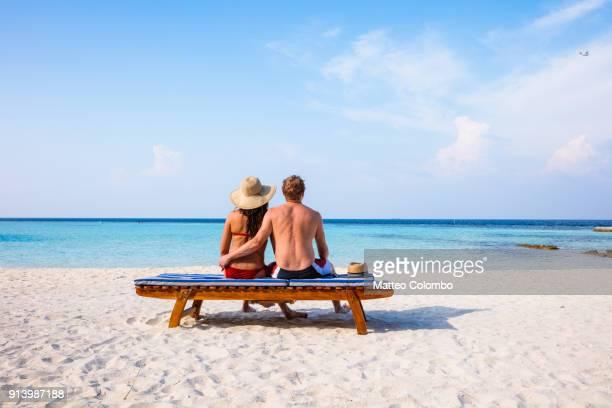 Couple on a beautiful sandy beach, Maldives