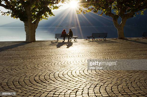 couple on a bench - ascona stock photos and pictures