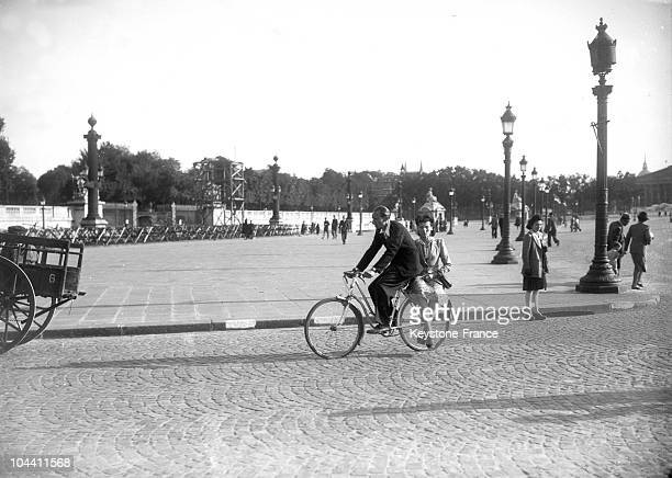 A couple on a bicycle at the Place de la Concorde in Paris around 1943 during the war