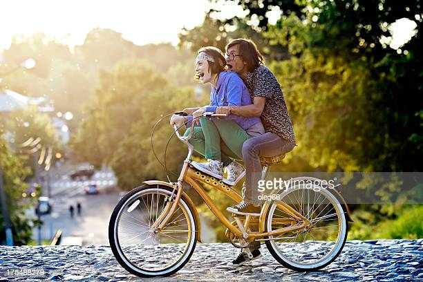 couple on a bicycle - freaky couples stock photos and pictures