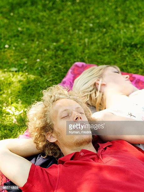 A couple on a blanket in the grass, Sweden.