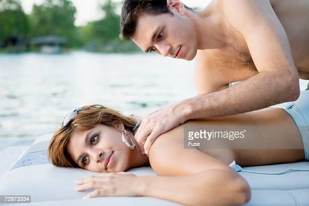 couple on a boat - massaggio sensuale foto e immagini stock
