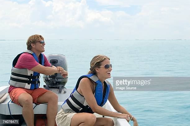 couple on a boat - life jacket stock pictures, royalty-free photos & images
