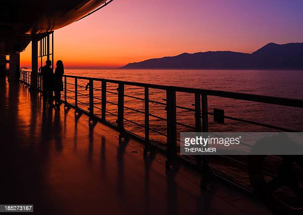 couple on a cruise ship at sunset - deck stock pictures, royalty-free photos & images
