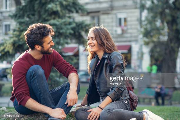 couple on a date at the park - couples dating stock pictures, royalty-free photos & images