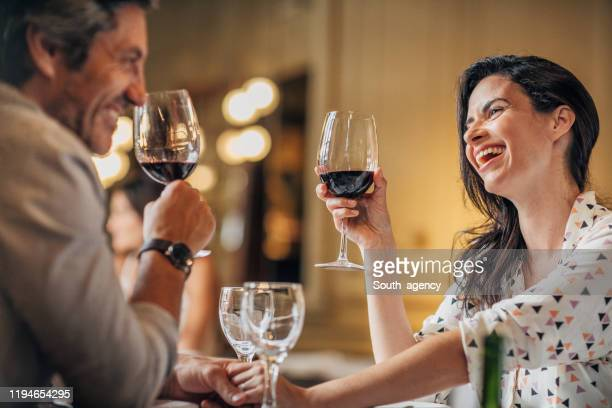 couple on a date in restaurant - romantic dinner stock pictures, royalty-free photos & images
