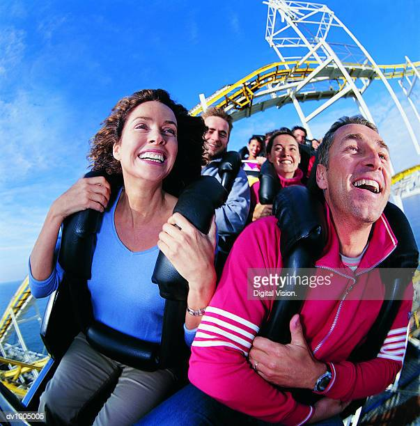 couple on a roller coaster - amusement park ride stock pictures, royalty-free photos & images