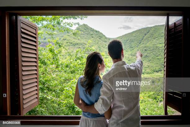 Couple on a romantic getaway looking at the view of their hotel room