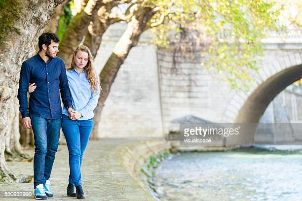 Couple On A Romantic Walk At A Riverbank