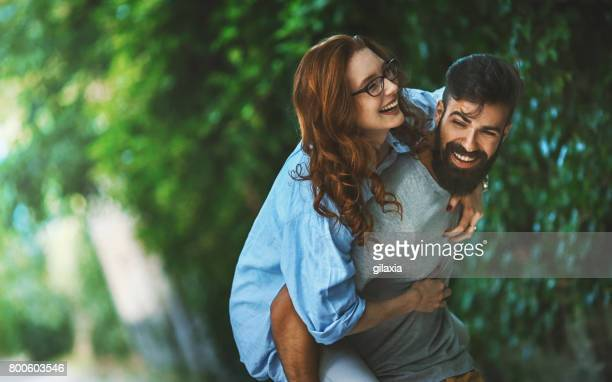 couple on a romantic walk. - boulevard stock pictures, royalty-free photos & images