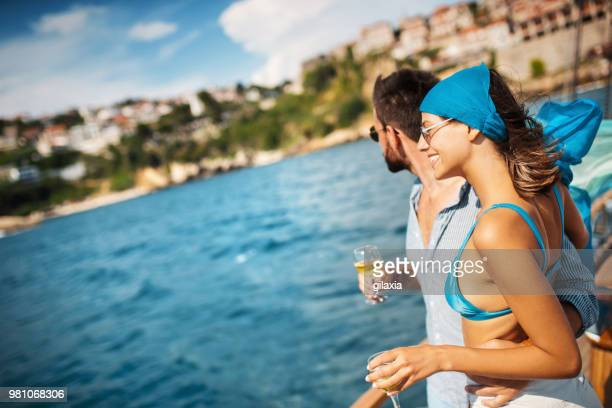 couple on a sailboat. - boat deck stock pictures, royalty-free photos & images