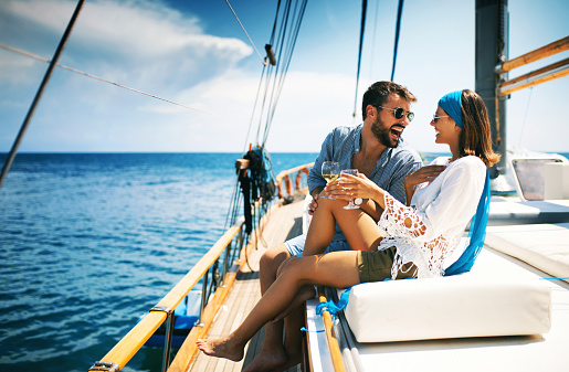 Couple on a sailboat. 987877042