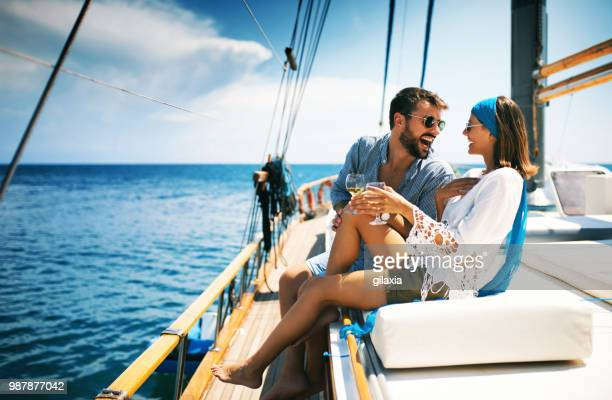couple on a sailboat. - small boat stock pictures, royalty-free photos & images