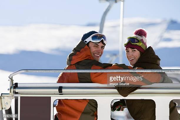 Couple on a ski lift