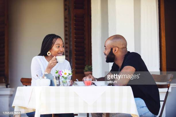 couple on a stoep having a meal together smiling - stoep stock pictures, royalty-free photos & images