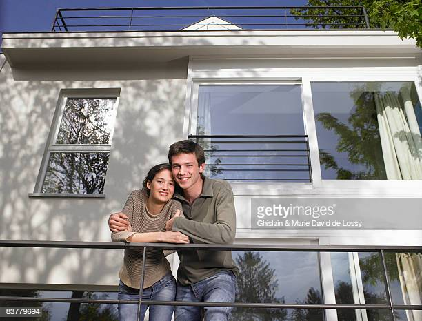 Couple on a terrace, smiling