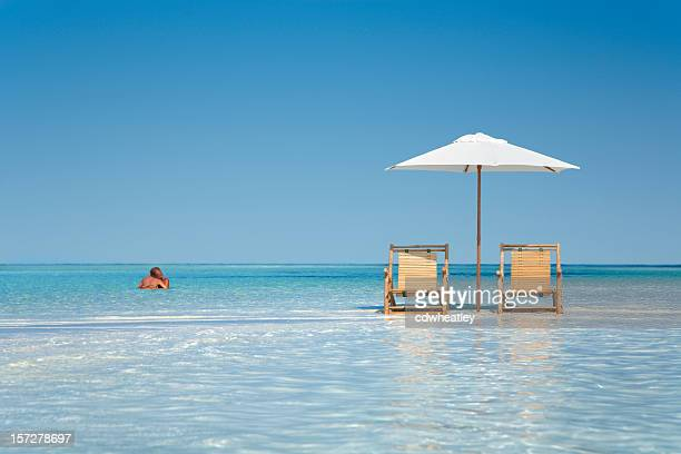 couple on a tropical beach - florida keys stock pictures, royalty-free photos & images