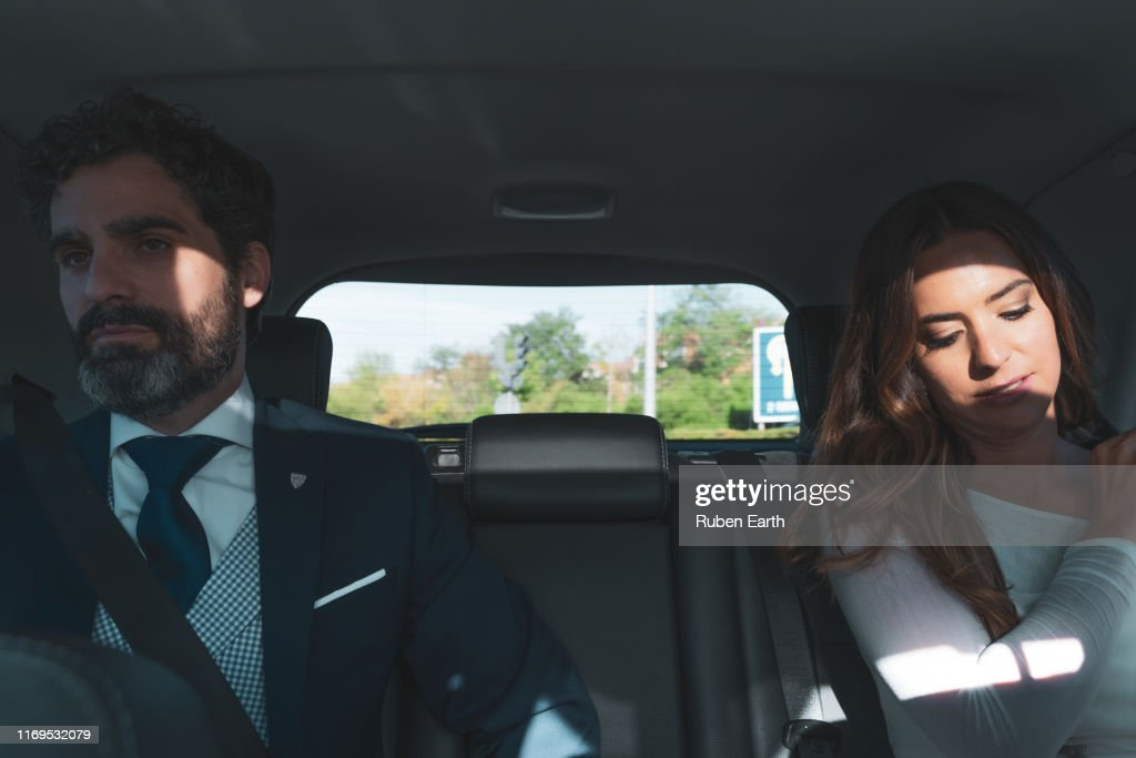 Couple on a wedding day, inside the car : Stock Photo