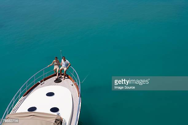 couple on a yacht in the sea - yacht stock pictures, royalty-free photos & images