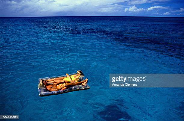 Couple on an Inflatable Mattress in the Sea