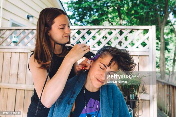 """couple on back deck getting haircut - """"marilyn nieves"""" stock pictures, royalty-free photos & images"""