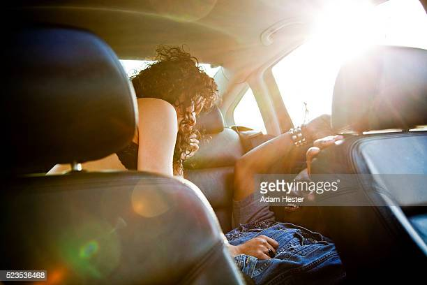 Couple on back seat of car