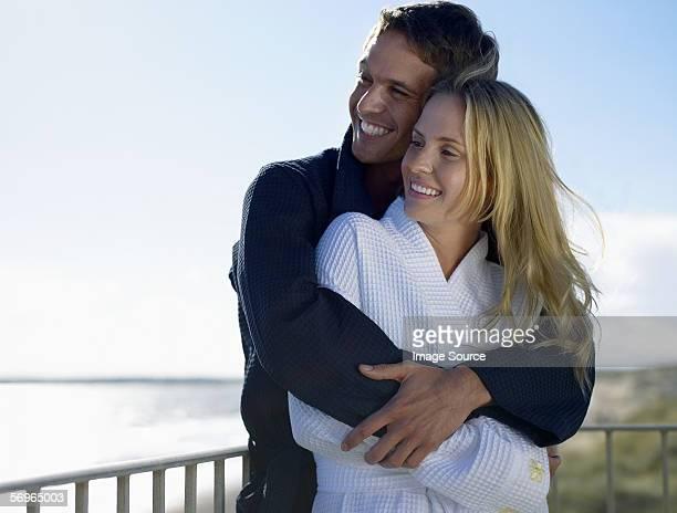 Couple on balcony in bathrobes
