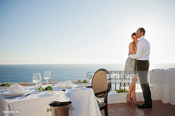 Couple on balcony of outdoor restaurant