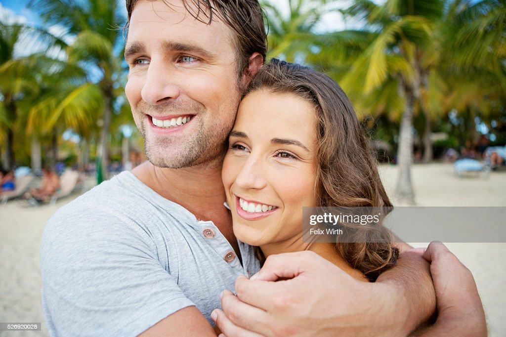 Couple on beach on summer day : Photo