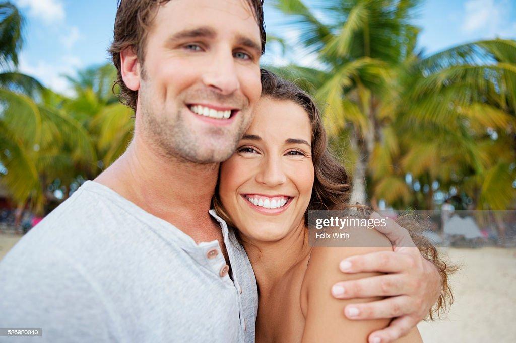 Couple on beach on summer day : ストックフォト