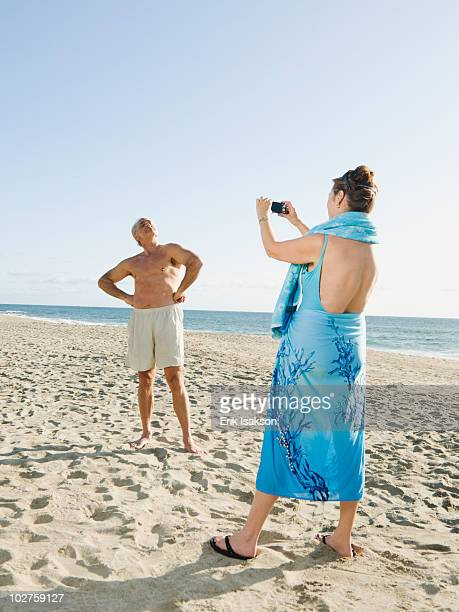 couple on beach - swimwear stock pictures, royalty-free photos & images