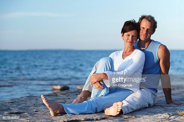 couple on beach - jim craigmyle stock pictures, royalty-free photos & images