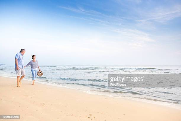 couple on beach - asian 50 to 55 years old woman stock photos and pictures