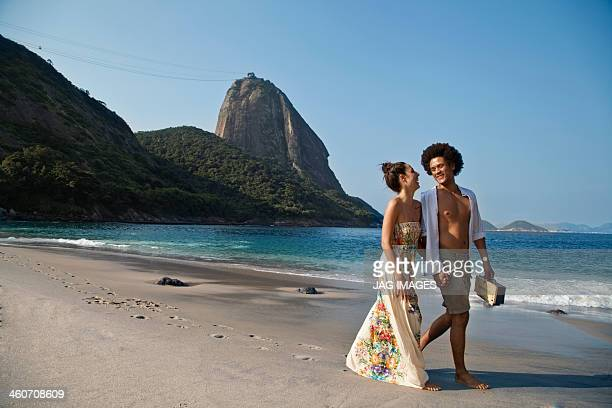 couple on beach, rio de janeiro, brazil - maxi dress stock pictures, royalty-free photos & images