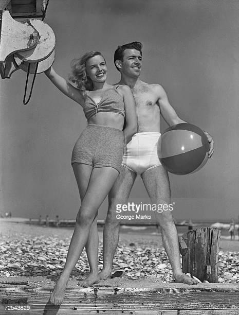 Couple on beach with beach ball