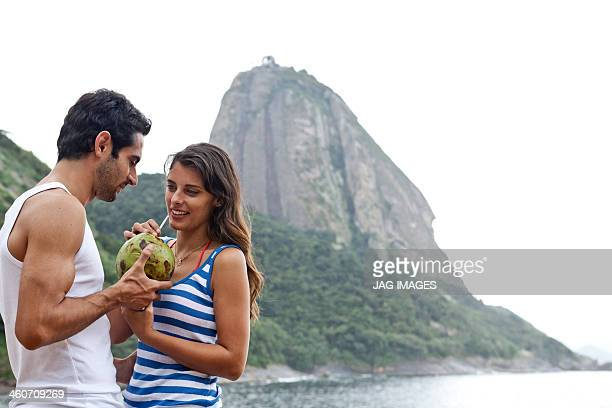 Couple on beach with Sugarloaf Mountain, Rio de Janeiro, Brazil