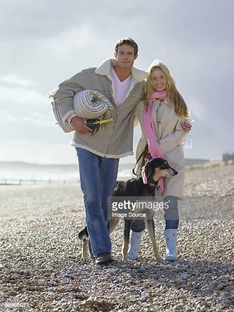 Couple on beach with their dog