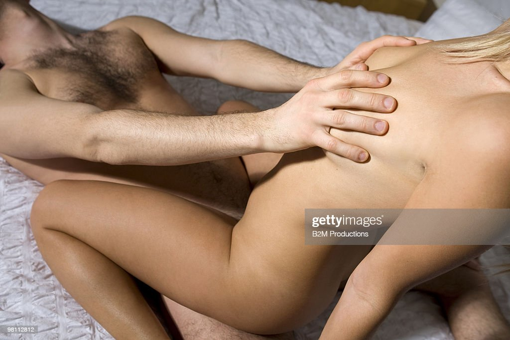 Couple On Bed Engaged In Sexual Intercourse Stock Photo -8900
