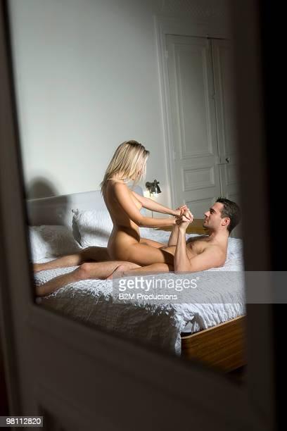couple on bed engaged in sexual intercourse - homens de idade mediana - fotografias e filmes do acervo