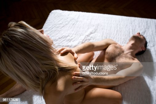 Couple On Bed Engaged In Sexual Intercourse Stock Photo -4412