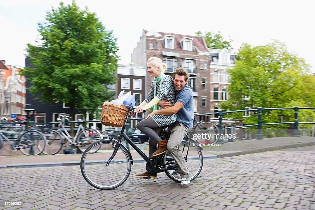 Couple on bicycle : Stock Photo