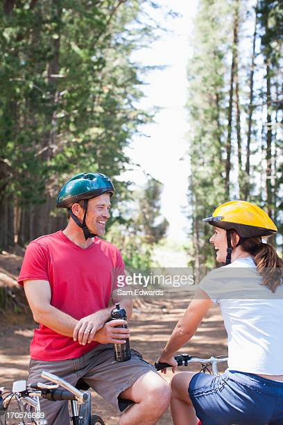 Couple on bicycles in forest