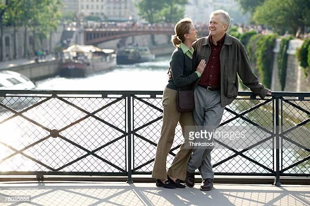 Couple on bridge over the Seine, Paris