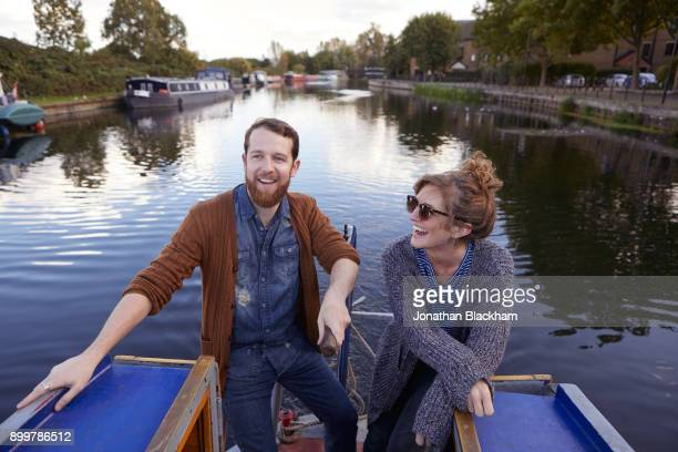 couple on canal boat - canal stock pictures, royalty-free photos & images