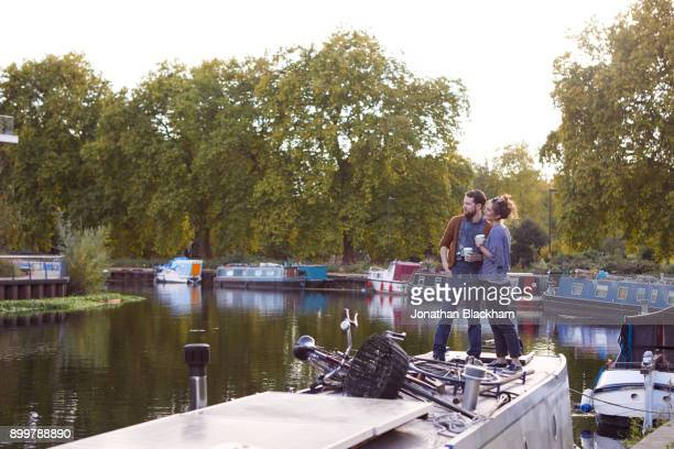 couple on canal boat - はしけ ストックフォトと画像