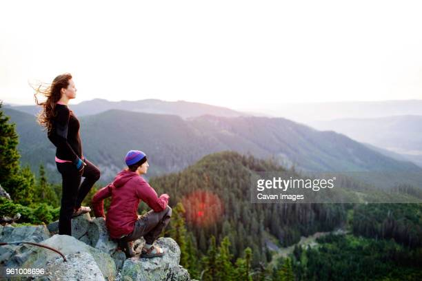 Couple on cliff looking at view
