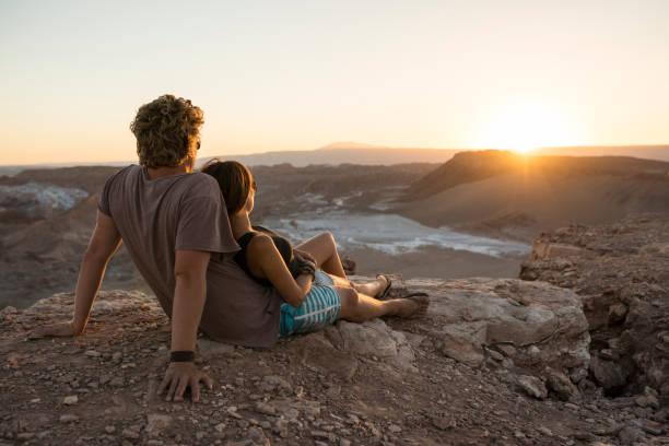 Couple on cliff, Valle de la Luna (Valley of the Moon), Atacama Desert, El Norte Grande, Chile