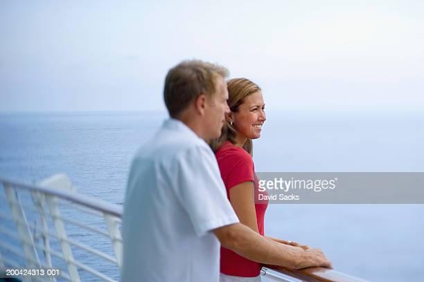 Couple on cruise ship, smiling