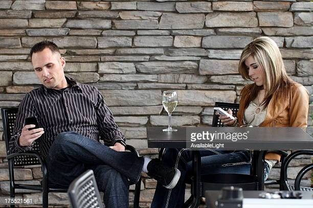 Couple on Date Ignoring Each Other